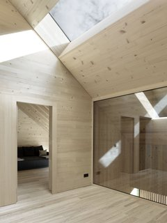 The ceilings of the attic slope downwards towards level of the cullis, to create a more cloistered atmosphere.