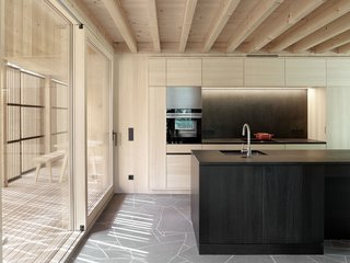 A kitchen with a Siemems integrated oven.