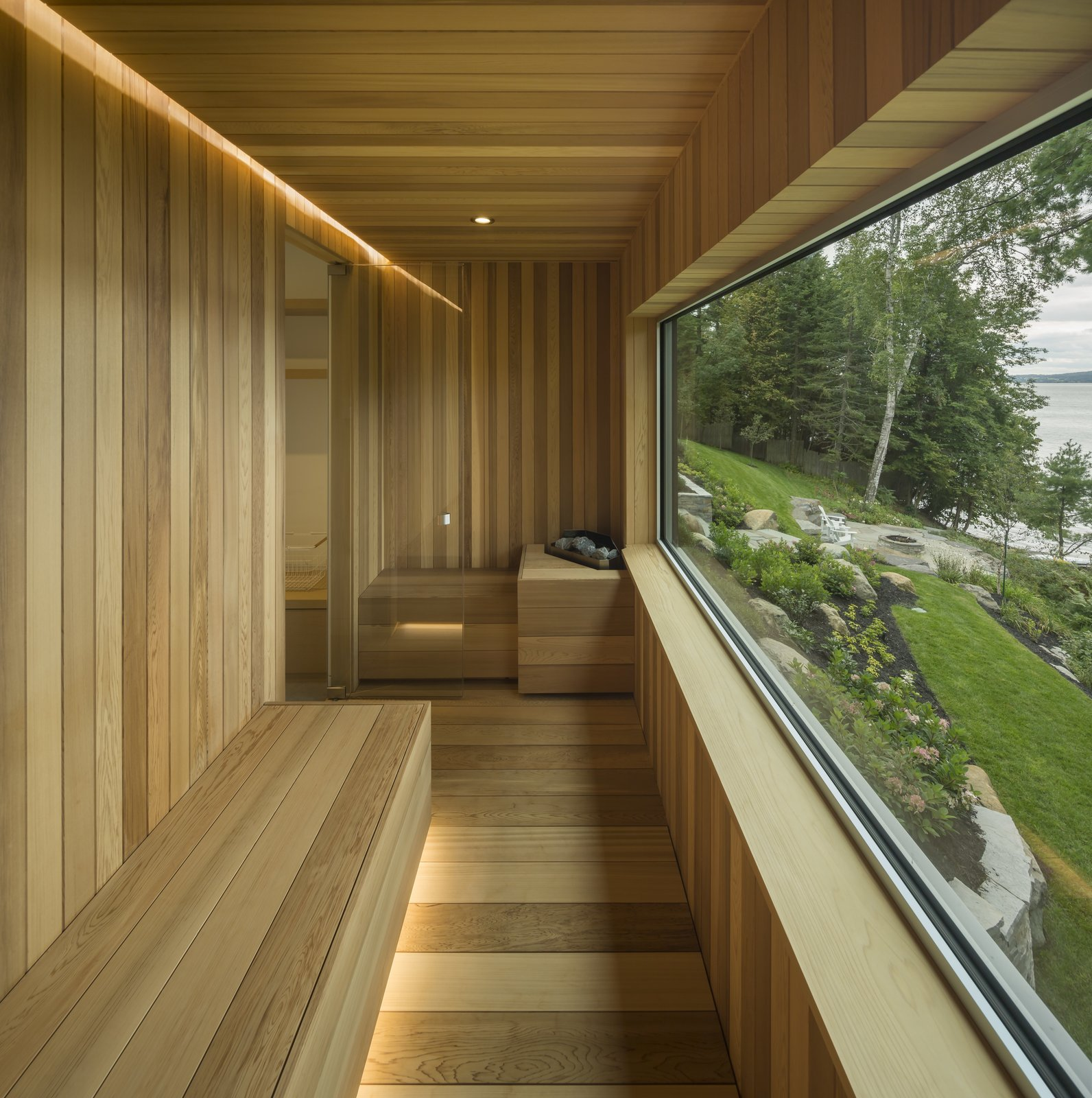 Windows, Picture Window Type, and Metal A sauna that looks out to the lake.  Photo 9 of 14 in A Lakeside Retreat in Quebec Looks Sharp With a Blade-Like Roof
