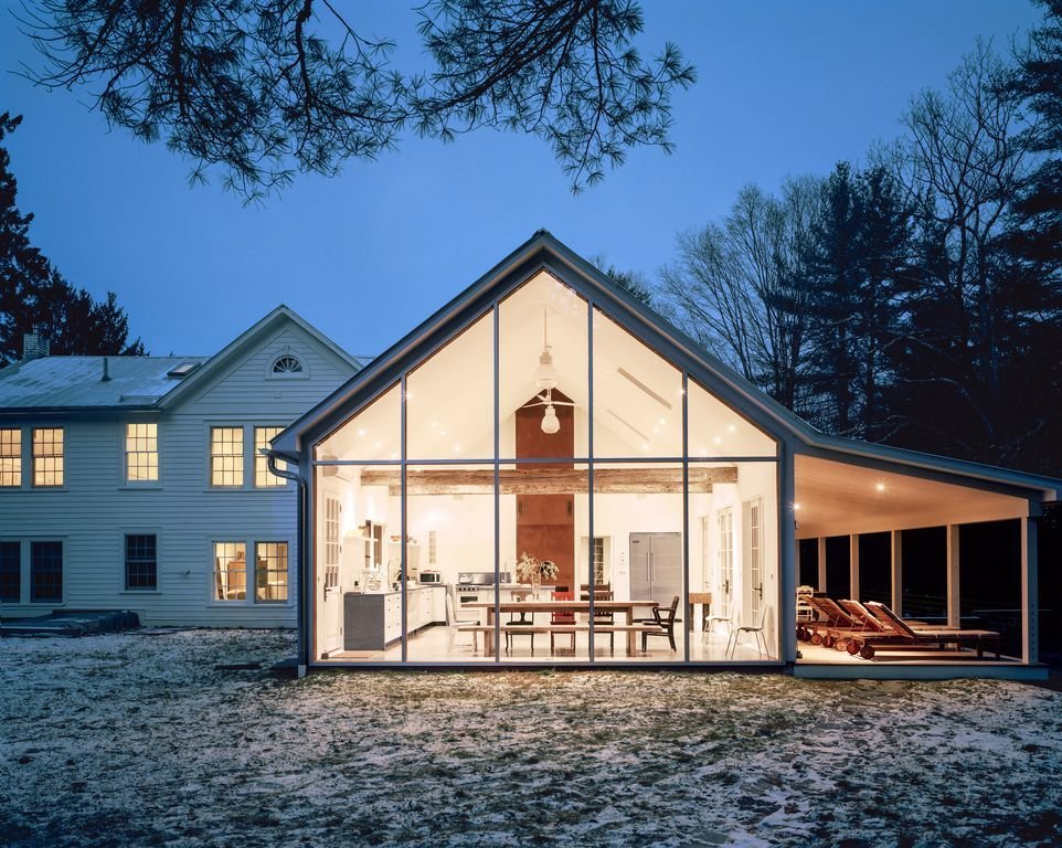 "Exterior, Glass Siding Material, Gable RoofLine, House Building Type, and Wood Siding Material ""Floating Farmhouse"" in Eldred New York is a modern five-room holiday rental home with a touch of old world charm.  Best Photos"