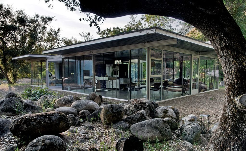 Exterior, Flat RoofLine, Metal Roof Material, Metal Siding Material, House Building Type, and Glass Siding Material A house of glass in the Sonoran Desert.  Photo 7 of 8 in 8 Glass Houses You Can Rent Right Now