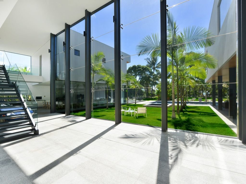 Hallway This holiday retreat in Cairns, Australia has eight-meter high full-height glass windows, and a 59-foot long lap pool.  Photo 6 of 8 in 8 Glass Houses You Can Rent Right Now