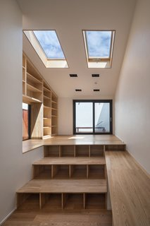 Steps with storage that lead up to the balcony.