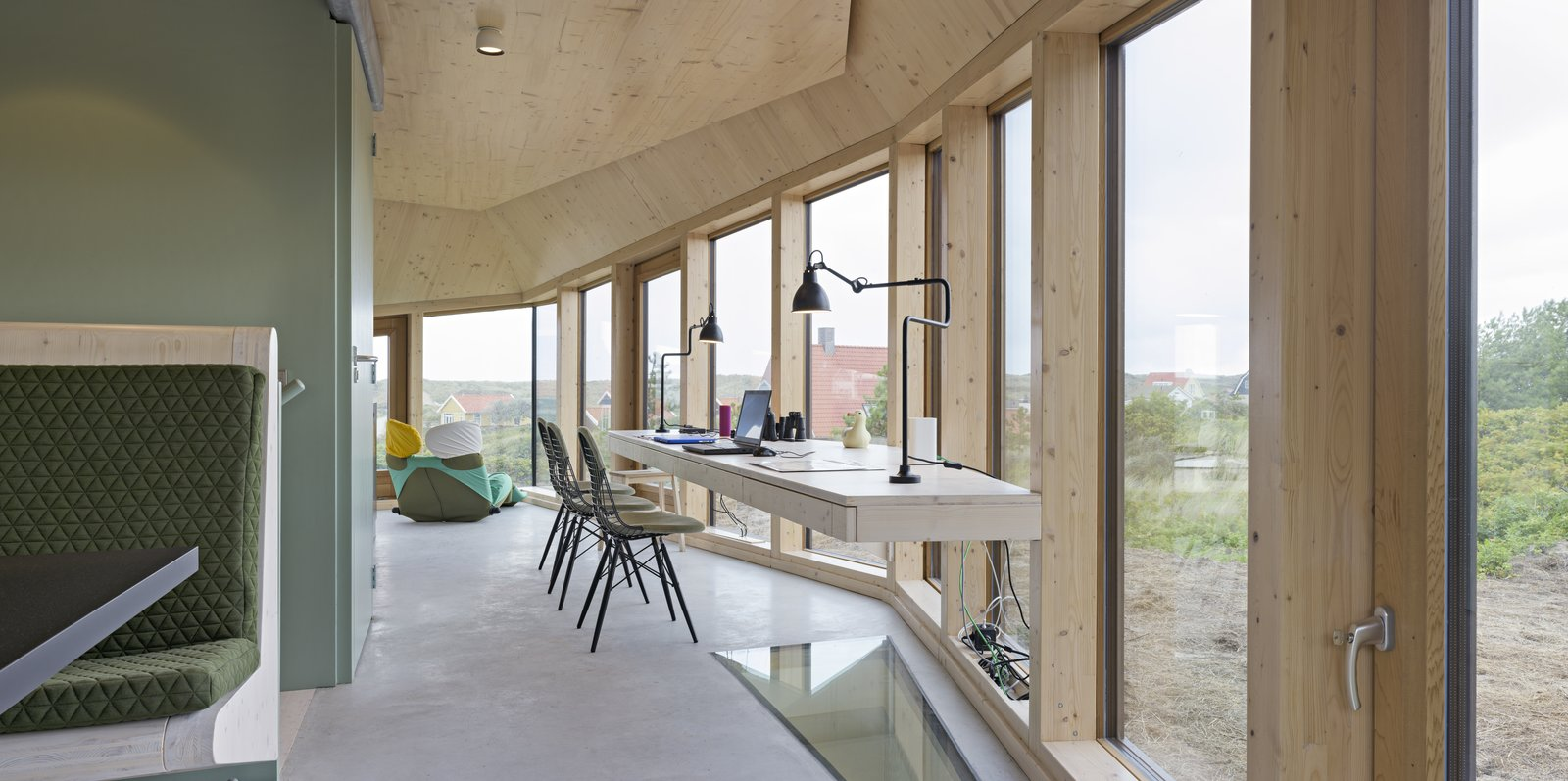 Office, Desk, Study Room Type, Chair, and Lamps A study desk on the ground floor.  Photo 5 of 11 in A Tent-Shaped Home in the Netherlands Crouches Between Natural Dunes
