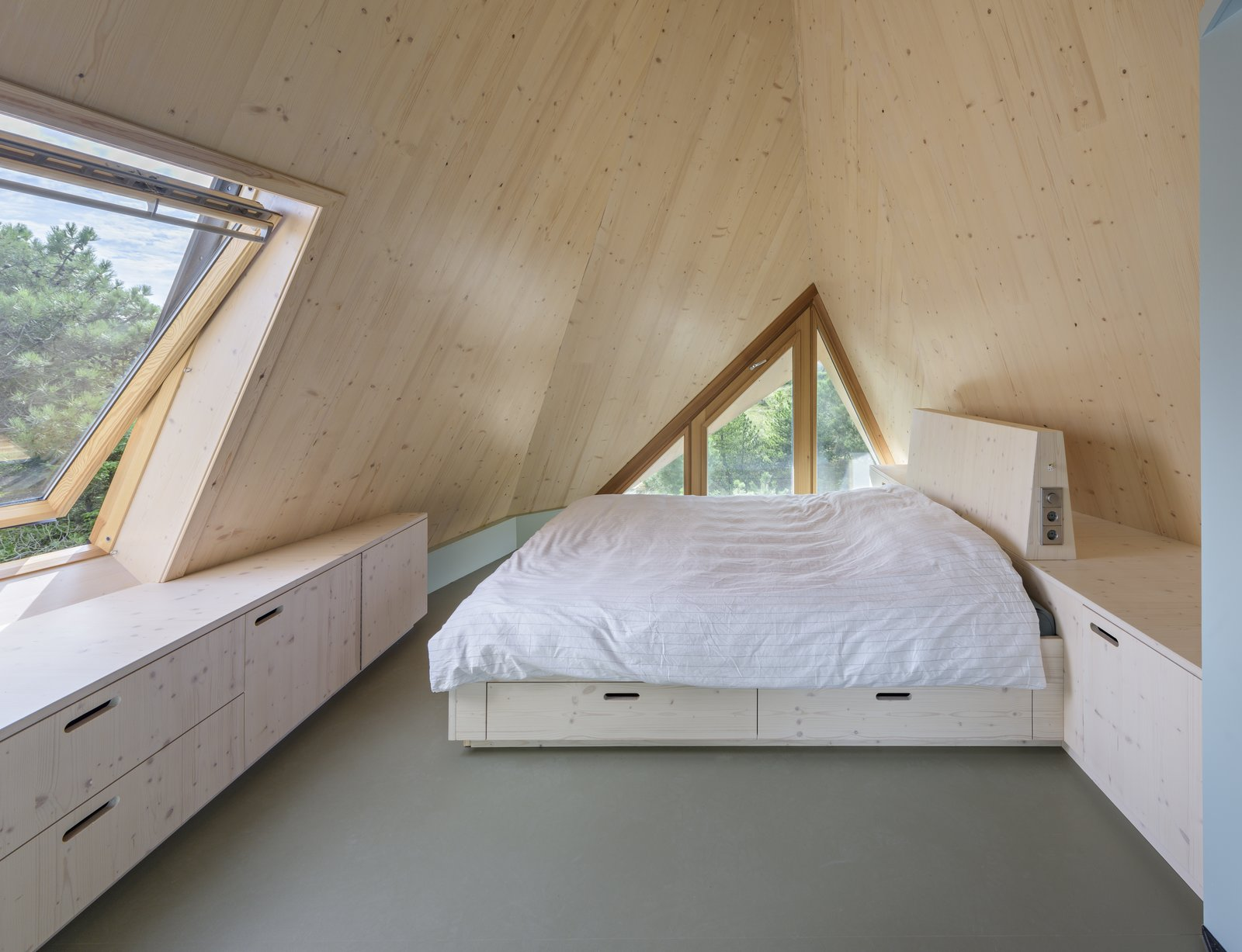 Bedroom, Bench, Bed, and Storage An attic bedroom.  Photo 7 of 11 in A Tent-Shaped Home in the Netherlands Crouches Between Natural Dunes