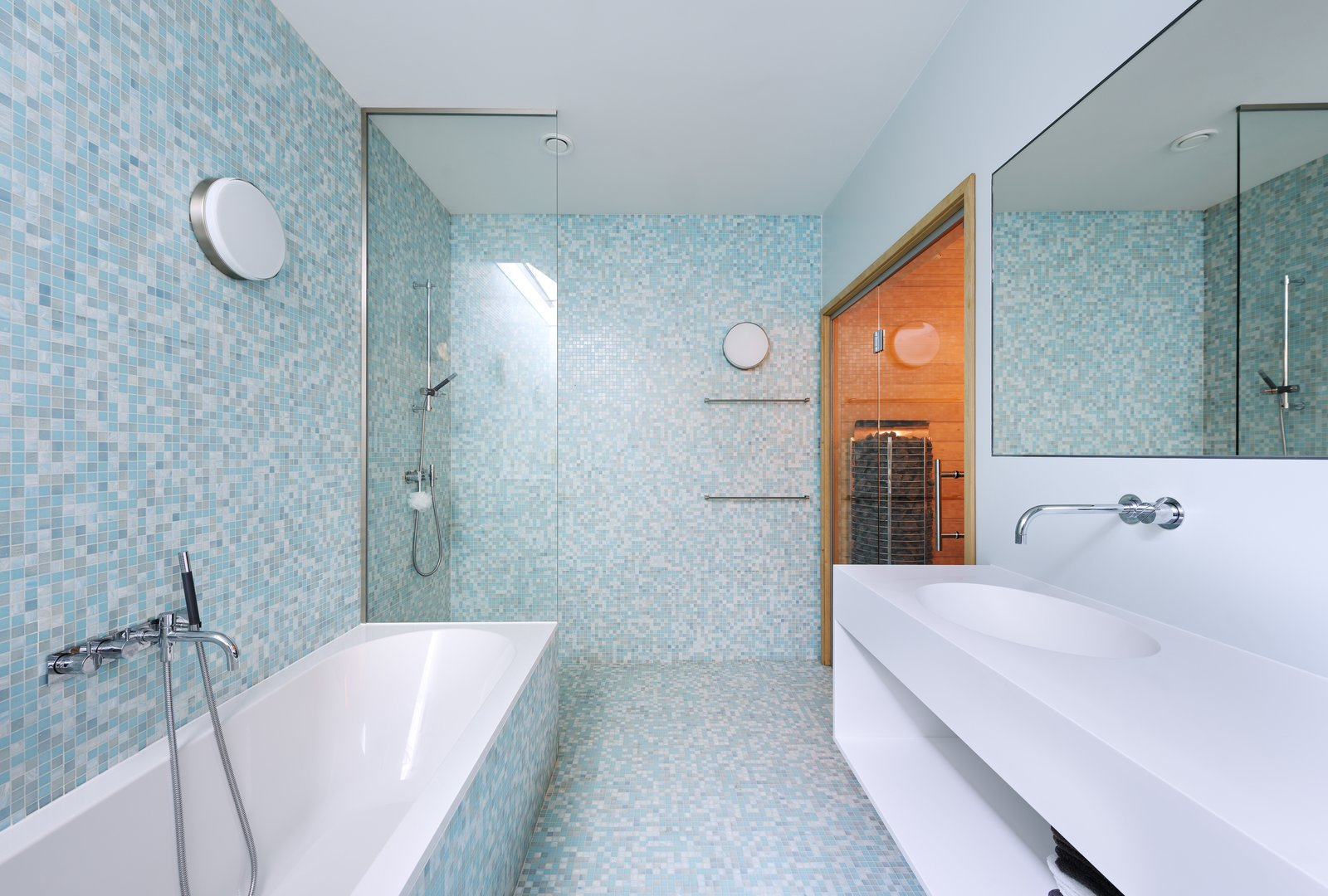 Bath, Drop In, Drop In, Open, Wall, and Mosaic Tile A cheerful, blue tiled bathroom.  Bath Drop In Wall Drop In Photos from A Tent-Shaped Home in the Netherlands Crouches Between Natural Dunes