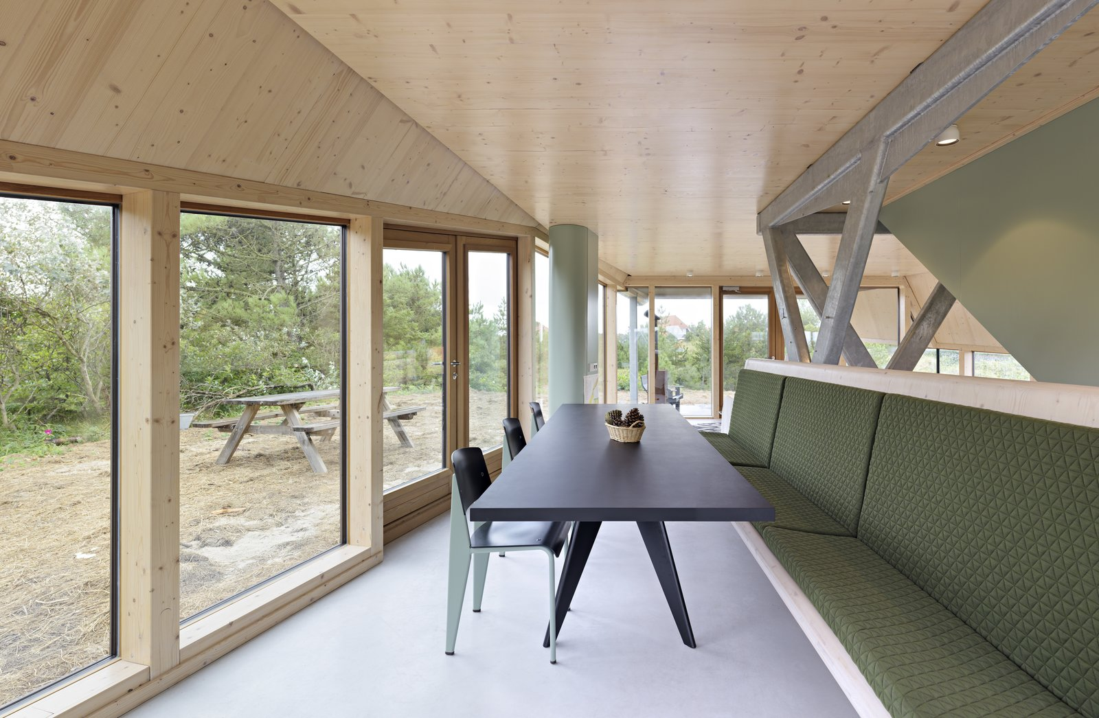 Dining Room, Bench, Table, Chair, and Ceiling Lighting A dining table and bench that can accommodate the large family who use the summer home.   Photo 2 of 11 in A Tent-Shaped Home in the Netherlands Crouches Between Natural Dunes