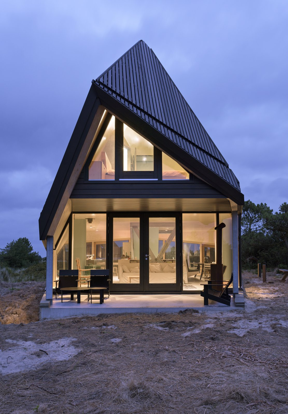 Exterior, House Building Type, and Glass Siding Material A covered porch on the ground floor.  Photo 4 of 11 in A Tent-Shaped Home in the Netherlands Crouches Between Natural Dunes