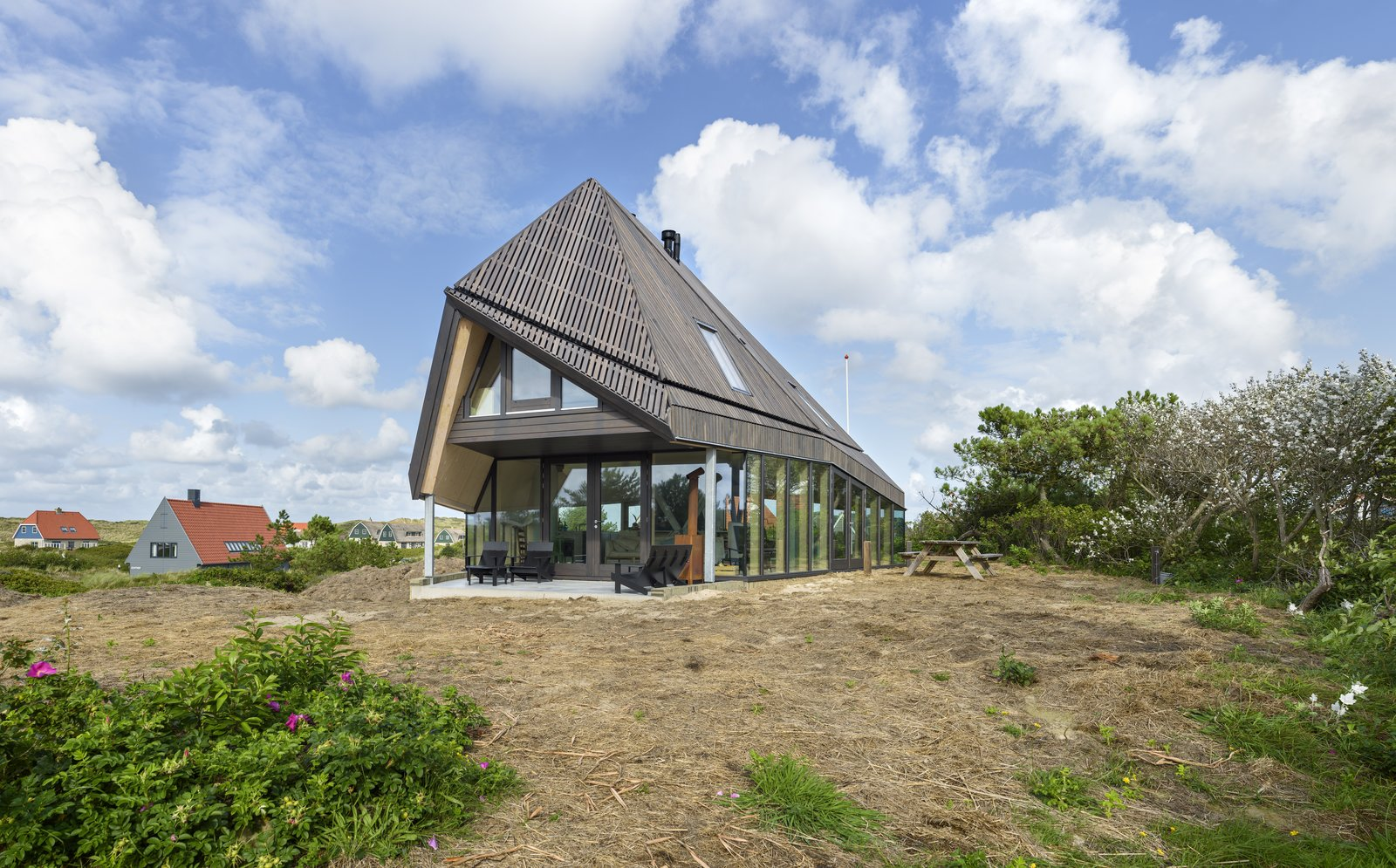 Exterior, House Building Type, and Glass Siding Material A high roof with a form that's inspired by the De Waard Albatross tent.  Photo 3 of 11 in A Tent-Shaped Home in the Netherlands Crouches Between Natural Dunes