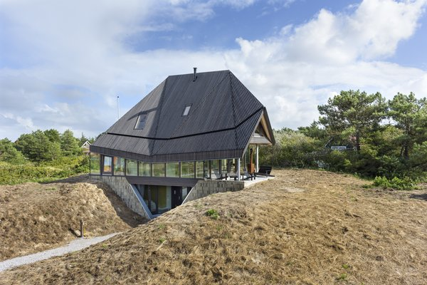 A Tent-Shaped Home in the Netherlands Crouches Between Natural Dunes