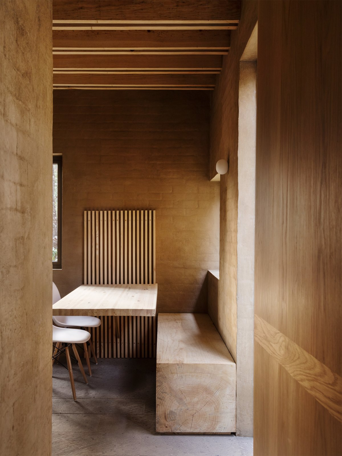 Dining Room, Wall Lighting, Chair, Bench, and Table A dining area with a built-in bench and table.  Best Photos from Five Cubist Hideaways Peek Out From a Mexican Pine Forest