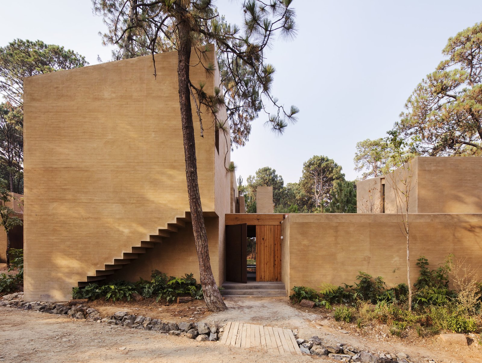Exterior, House Building Type, Flat RoofLine, and Brick Siding Material The entrance to the weekend home.  Best Photos from Five Cubist Hideaways Peek Out From a Mexican Pine Forest