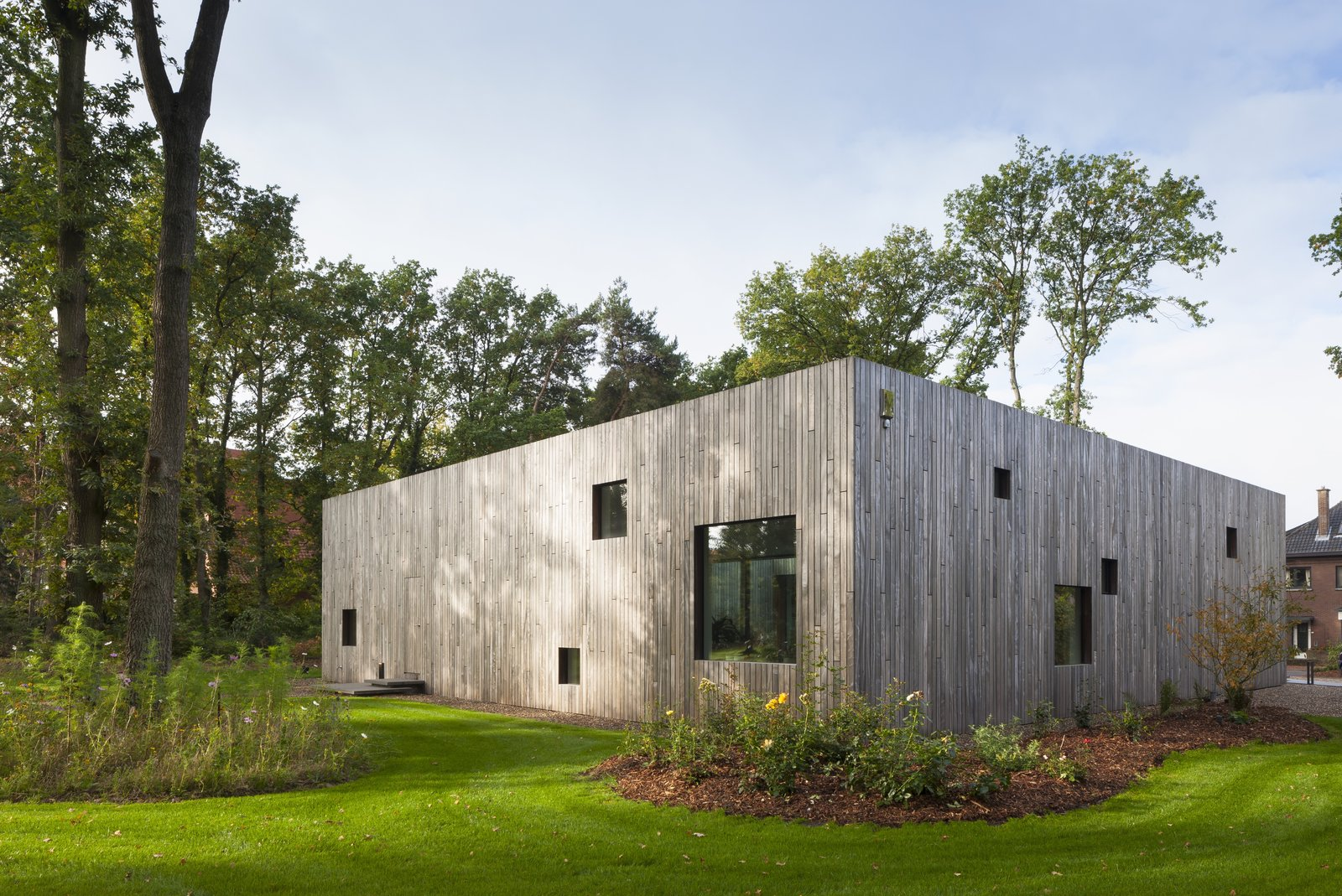 Exterior, Wood Siding Material, House Building Type, and Flat RoofLine The house was constructed with a wooden frame and cellulose insulation.  Best Photos from A Belgian Architect's Courtyard House Offers Work/Life Balance