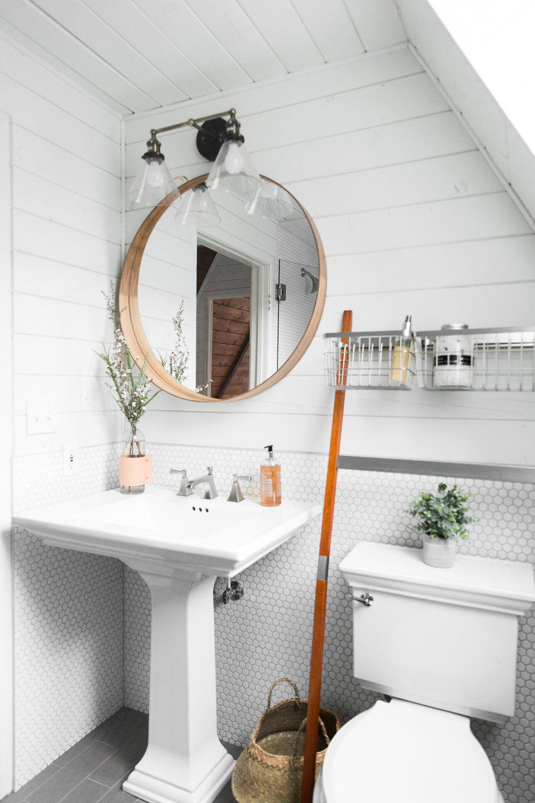 Bath Room Two Piece Toilet Wall Lighting And Pedestal Sink A Bathroom With