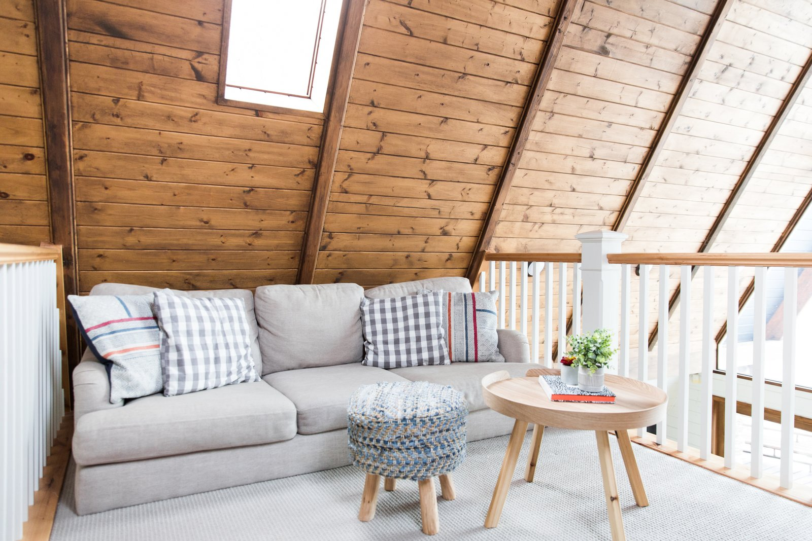 Living Room, Ottomans, Sofa, End Tables, and Rug Floor A lofted lounge area.  Photo 12 of 14 in Before & After: An A-Frame Cabin Boasts Serious Scandinavian Vibes