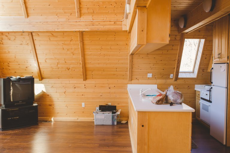 The kitchen before renovation was significantly smaller.  Photo 2 of 14 in Before & After: An A-Frame Cabin Boasts Serious Scandinavian Vibes