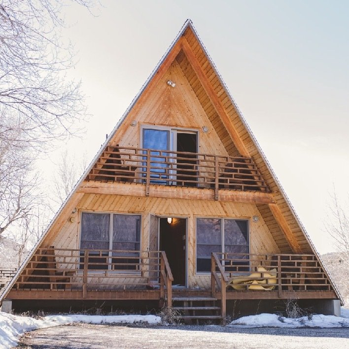 The exterior of the cabin, which is more than 30 years old.  Photo 1 of 14 in Before & After: An A-Frame Cabin Boasts Serious Scandinavian Vibes
