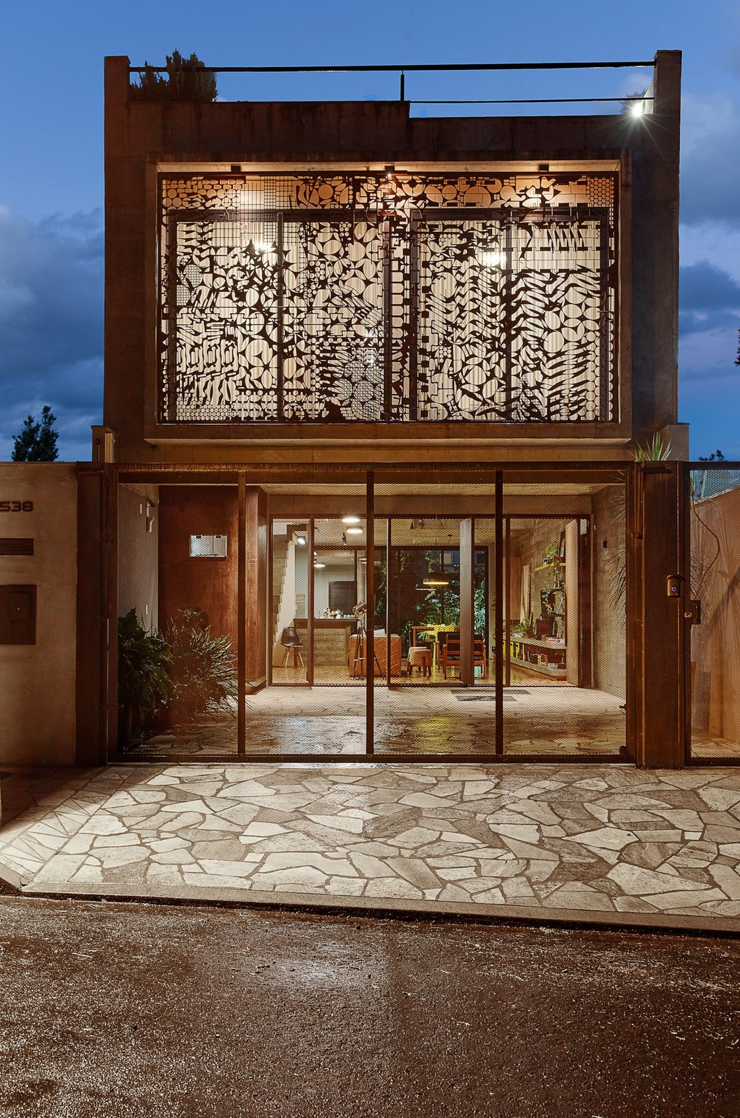 Exterior, Concrete Siding Material, House Building Type, and Flat RoofLine A Corten steel sculpture designed by the plastic artist Nivaldo Tonon.   Photo 5 of 14 in This Slender Concrete Home in Brazil Feels Like an Urban Jungle