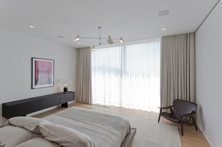 The chandelier in one of the bedrooms is by David Weeks.