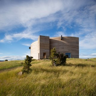 This by Chilean practice Pezo von Ellrichshausen Arquitectos is built with local timber, with 45 rigid frames set in a fan-shaped configuration.
