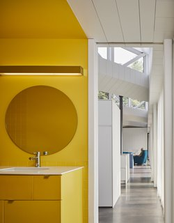 A cheerful yellow bathroom.