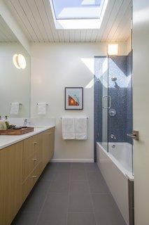 A skylight brightens one of the new bathrooms.