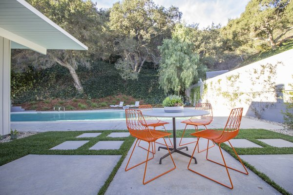 An outdoor patio where the owners can enjoy some Californian sunshine after a swim.