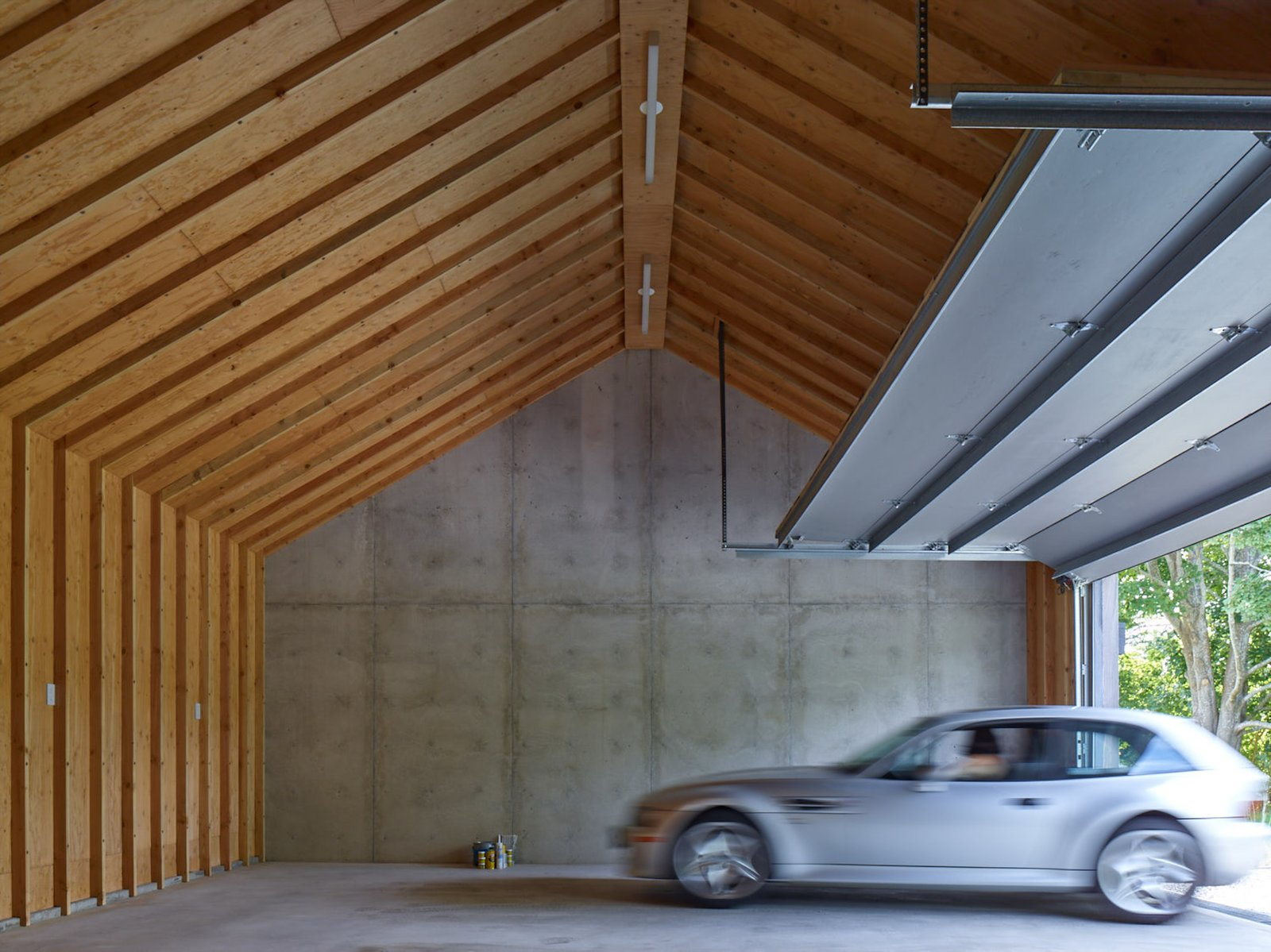 Garage The garage behind the concrete wall.  Best Garage Photos from This Stunning Suffolk County Home Brings a Modern Twist to a Historic Area