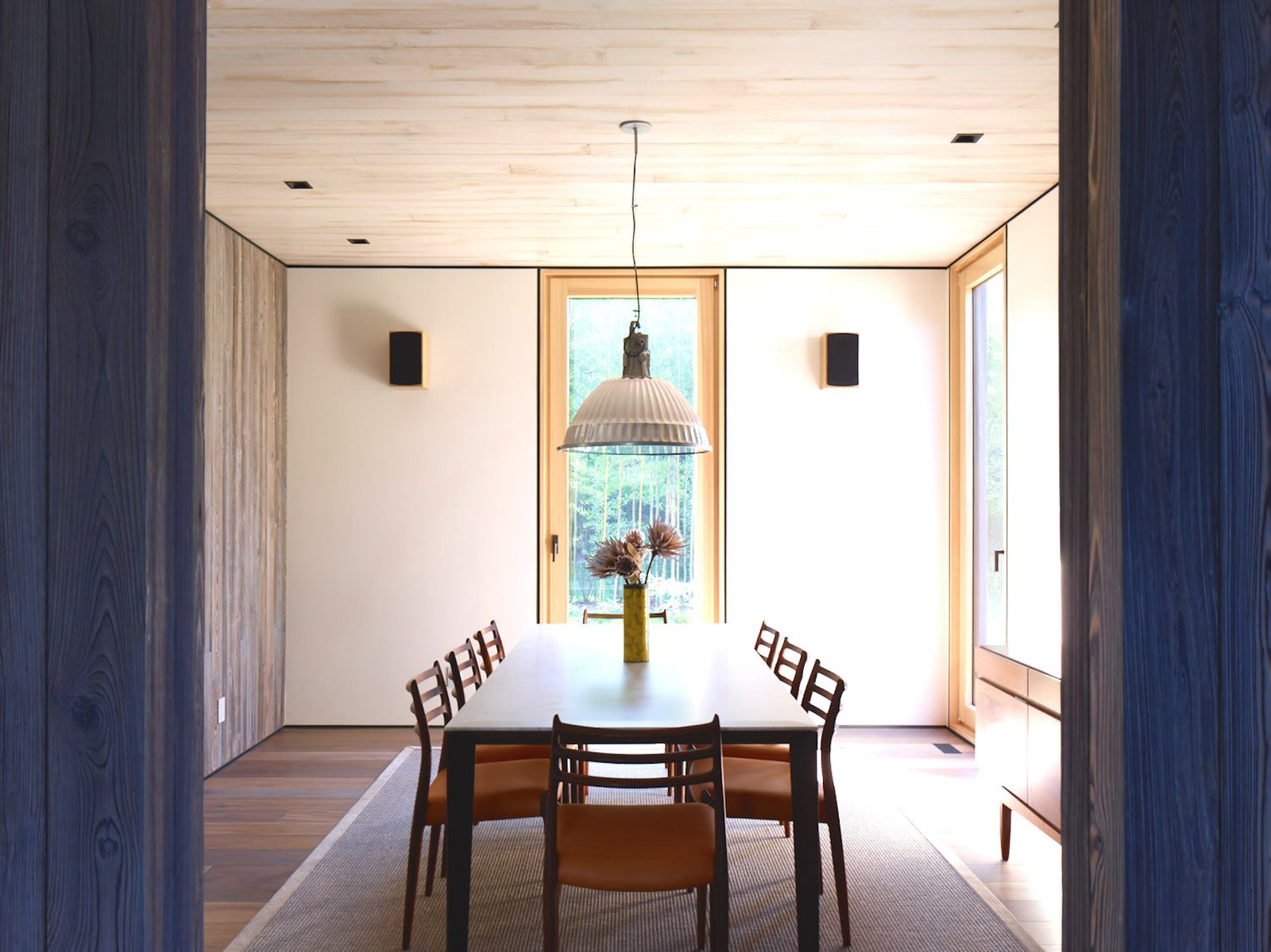 Dining, Medium Hardwood, Chair, Pendant, Table, Rug, Storage, and Recessed A suspension lamp by Fontana Arte.  Best Dining Rug Recessed Photos from This Stunning Suffolk County Home Brings a Modern Twist to a Historic Area