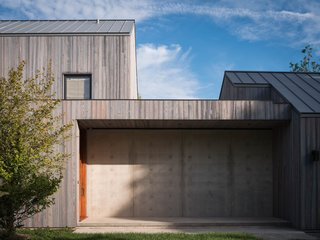 A house in Suffolk County with concrete foundational walls, charred siding siding and VMZinc zinc roof.
