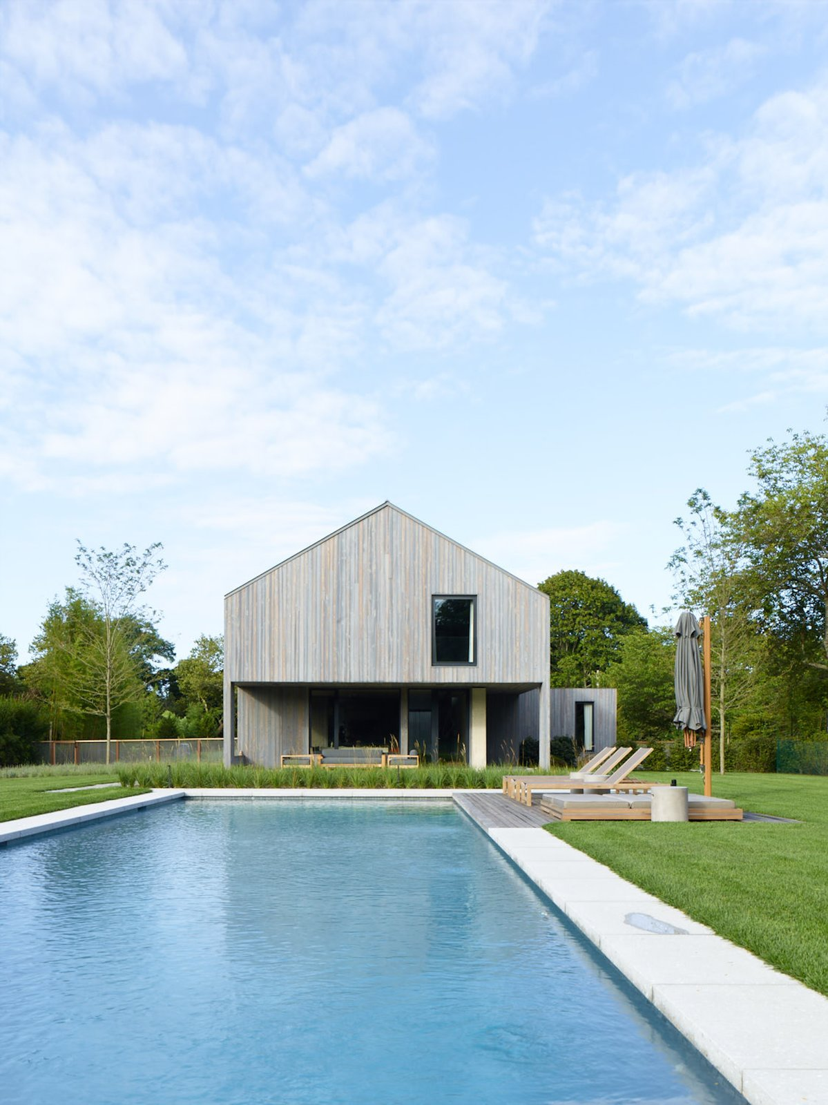 Outdoor, Large, Back Yard, Trees, Wood, Grass, and Lap An expansive lap pool.  Best Outdoor Lap Trees Photos from This Stunning Suffolk County Home Brings a Modern Twist to a Historic Area