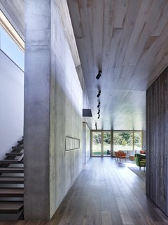 The rich textural contrast between concrete and wood on the façade, is repeated with the interiors.