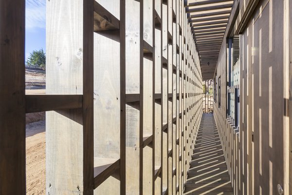Large openings in the latticework facade brings in sunshine and sea breezes.