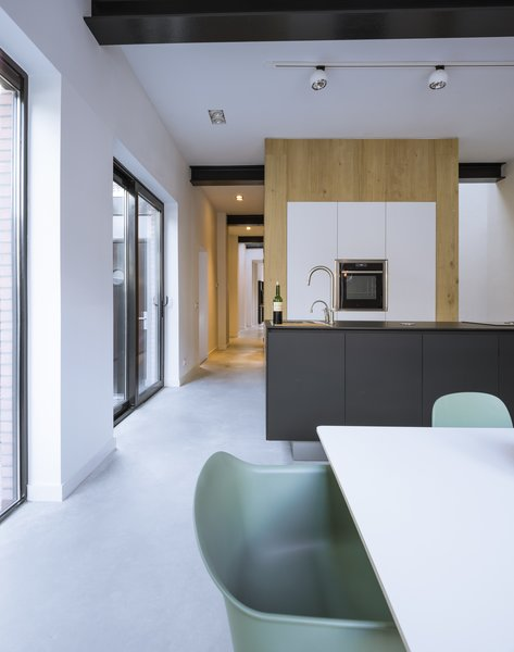 A sleek, streamlined open concept kitchen.
