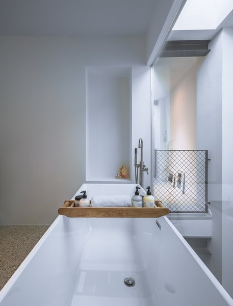 The Bathtub Rests Along A Fully Glazed Wall And Looks Down To Living