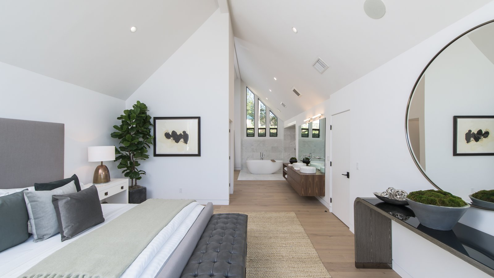Bedroom, Night Stands, Light Hardwood, Bed, Recessed, Lamps, and Dresser The master bedroom has a bathroom with a spa-tub.  Best Bedroom Recessed Lamps Photos from Red Hot Chili Peppers Frontman Anthony Kiedis' Former L.A. Abode Asks $3.2M