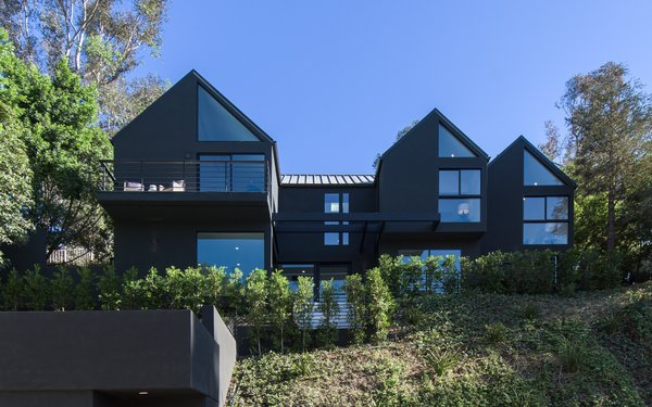 The house has a standing-seam metal roof and  is finished with black-tinted stucco and a standing-seam metal roof.