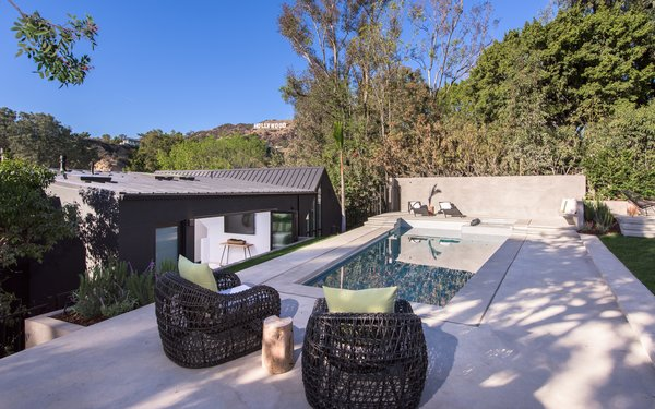 The pool is located in the rear yard, where the Hollywood Sign can be seen.