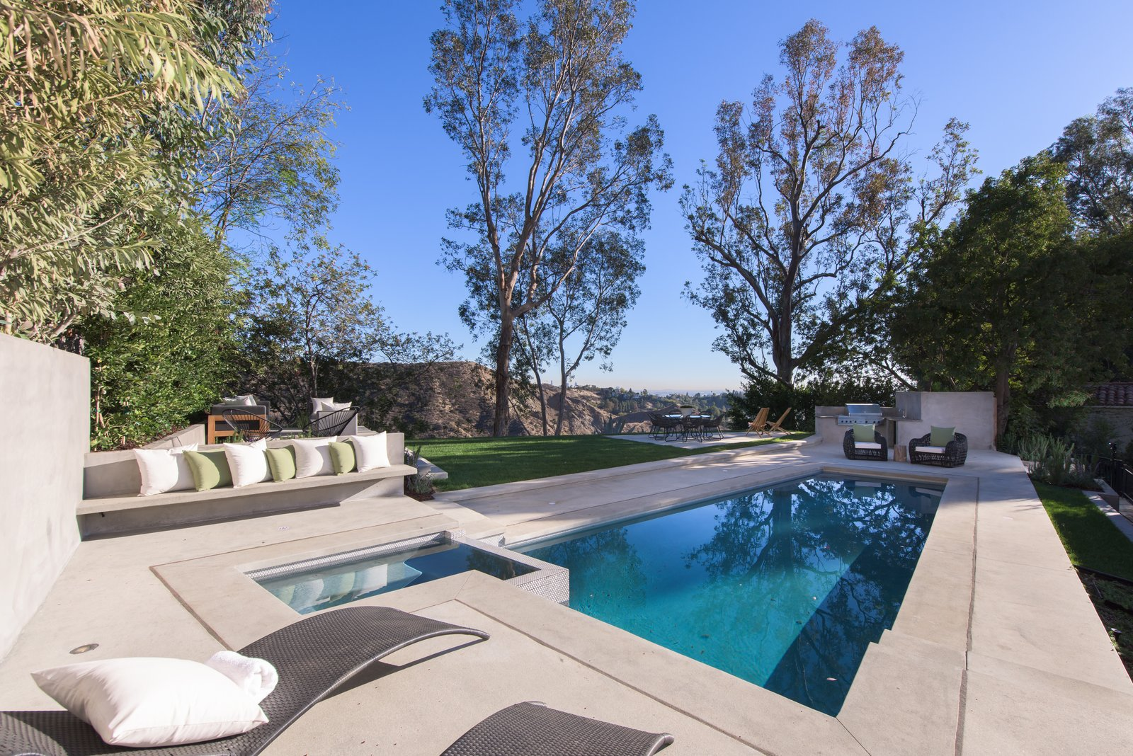 Outdoor, Small, Large, Grass, Back Yard, Trees, Hot Tub, and Plunge An outdoor kitchen, green lawn and pool makes the rear-yard the perfect spot of outdoor soirees.  Best Outdoor Plunge Hot Tub Photos from Red Hot Chili Peppers Frontman Anthony Kiedis' Former L.A. Abode Asks $3.2M