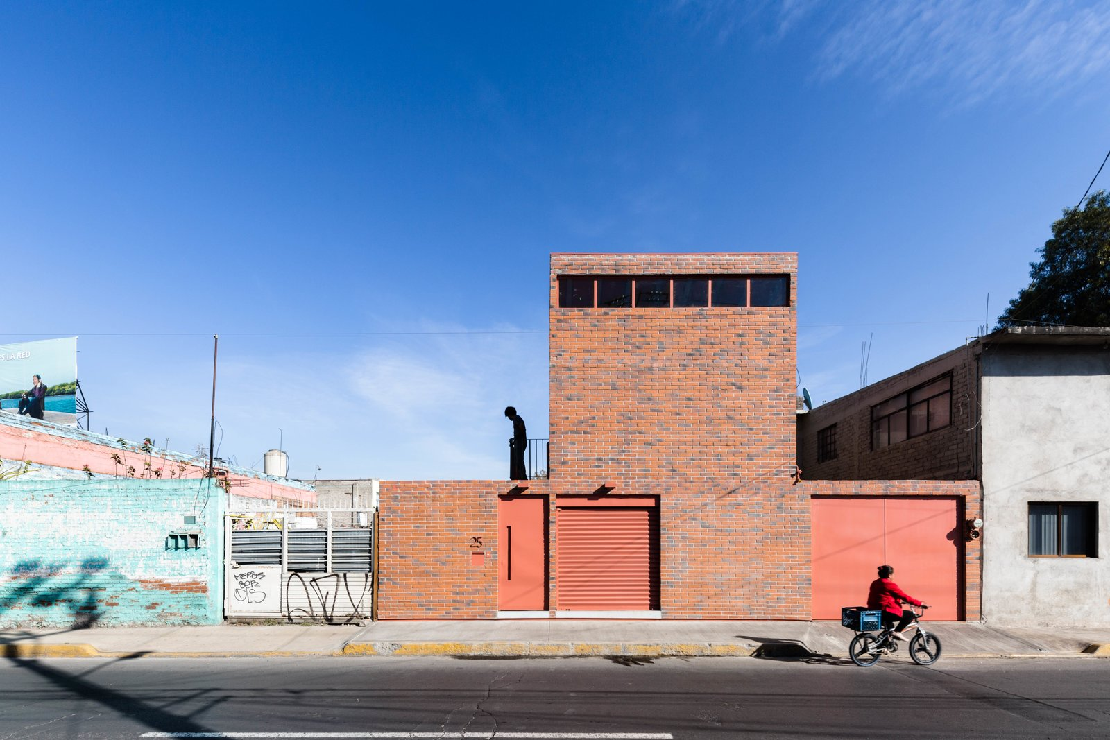 A solution to cramped urban living in Texcoco, Mexico. Tagged: Exterior, House, Brick, and Sawtooth.  Best Exterior House Brick Photos from Before and After: A Cramped Home in Mexico Gets a Drastic Makeover on a Tight Budget