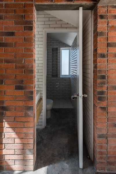 A bathroom fitted with white tiles.