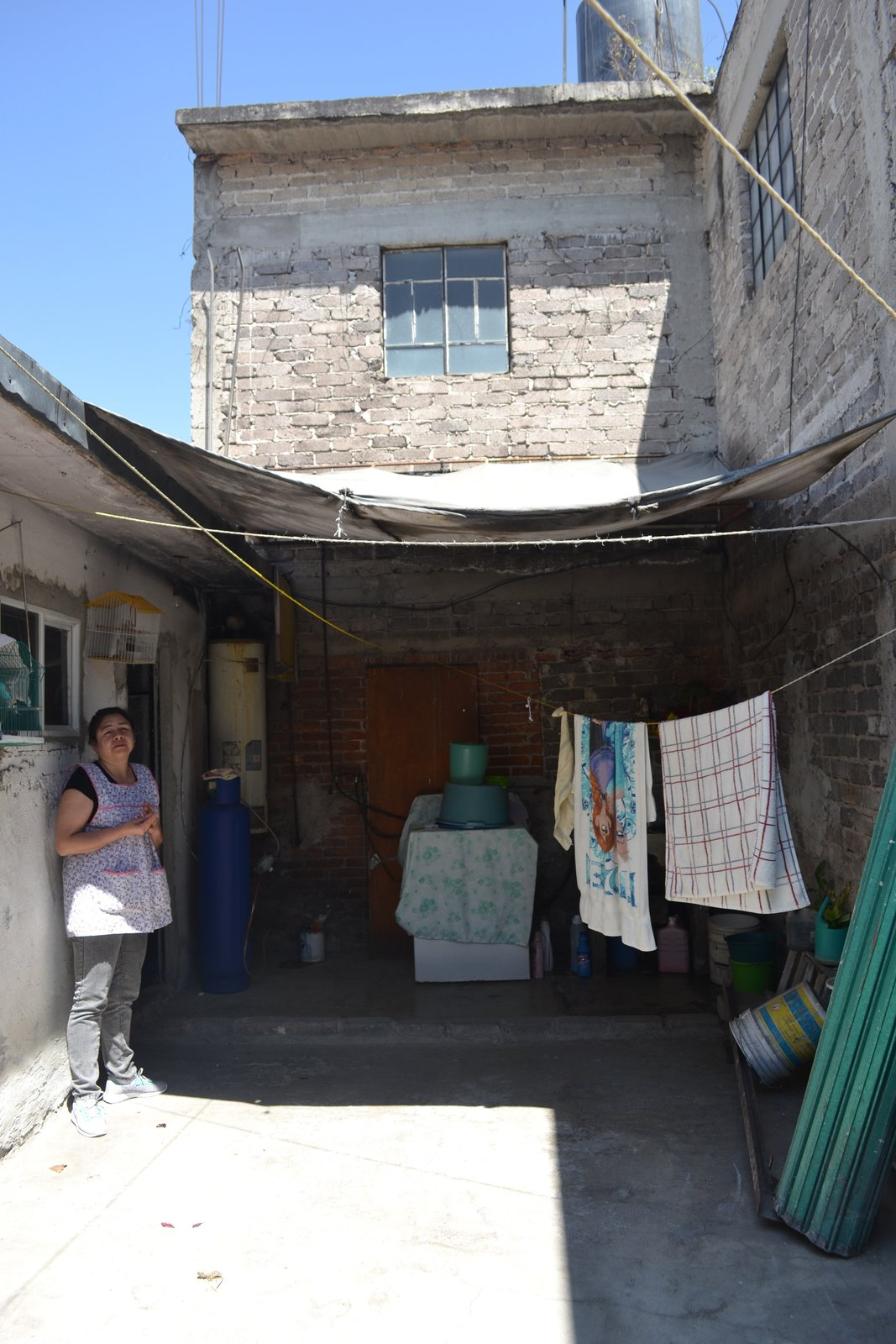 The courtyard of the Mexican family home before the renovation.  Photo 3 of 18 in Before & After: A Cramped Home in Mexico Gets a Drastic Makeover on a Tight Budget