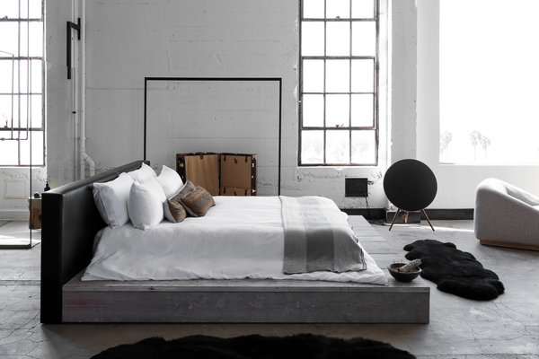 One of the tricky things about low bed frames is that bed linens are designed to hang off the mattress, usually down past a box spring. So if you're letting your mattress rest directly on the floor or are placing it on a platform bed, you'll want to let the sheets and covers flow evenly onto the platform so that it looks considered, yet casual.