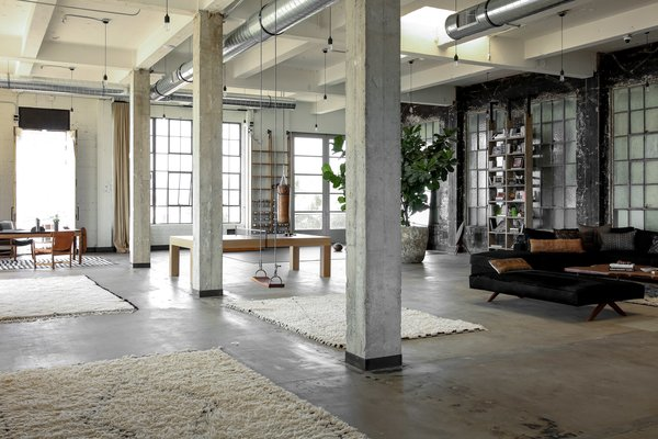 The existing space's concrete floors and zinc windows were restored.