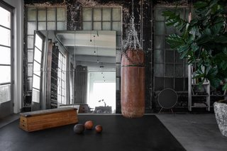 A corner that's used as a home gym.