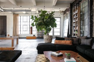 Vintage Beni Ourain rug and custom scaffold plank floor to ceiling shelving by alexander design and PSS Design Cult.