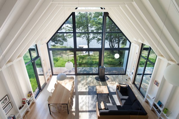 Floor-to-ceiling glass windows seamlessly connect the indoor spaces to the outdoors.