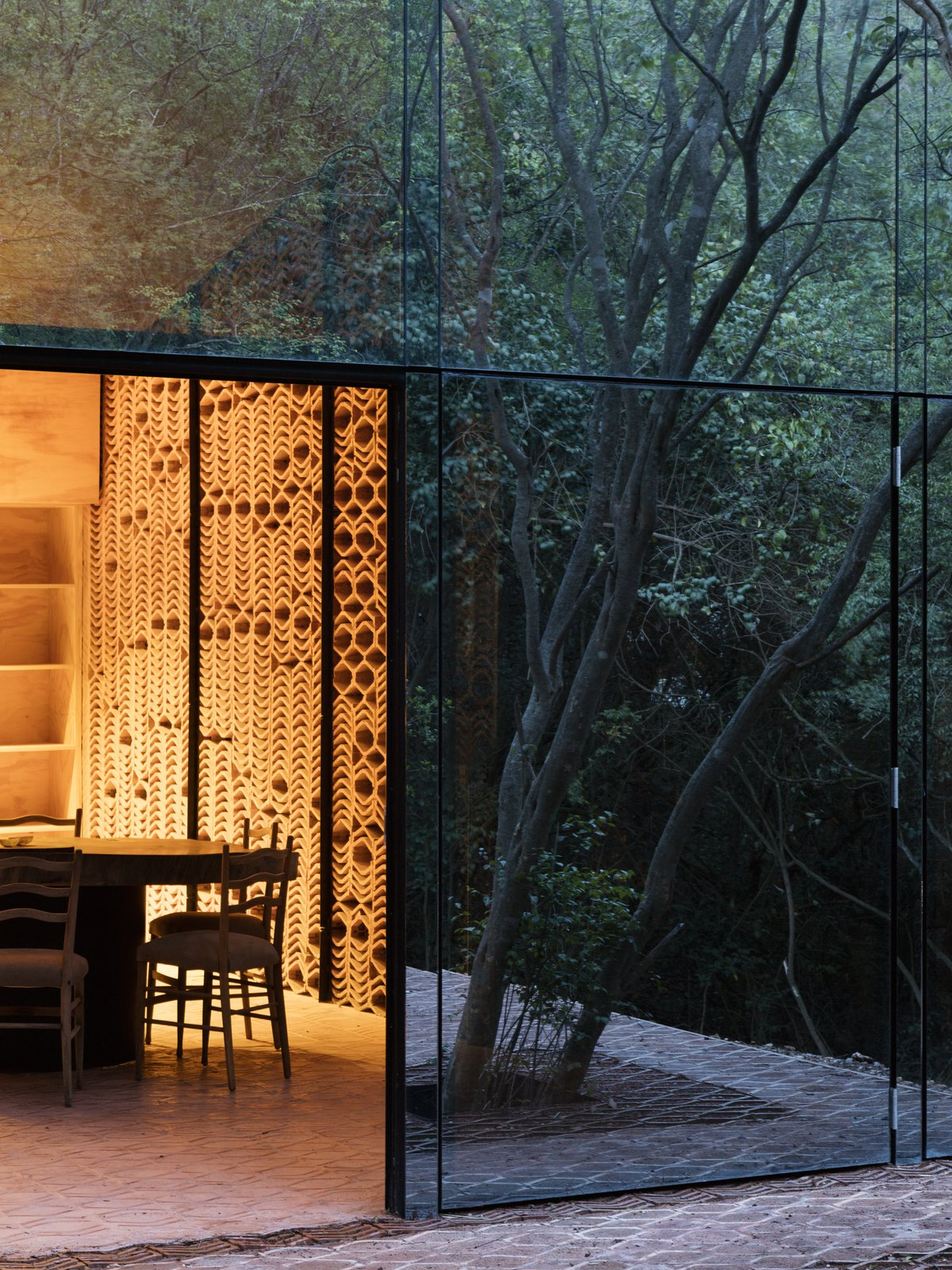 Exterior, House Building Type, and Glass Siding Material In the evening, the facade darkens as the sun sets outdoors.  Photo 6 of 16 in A Mirrored Mexican Home Hides Among a Lush Forest