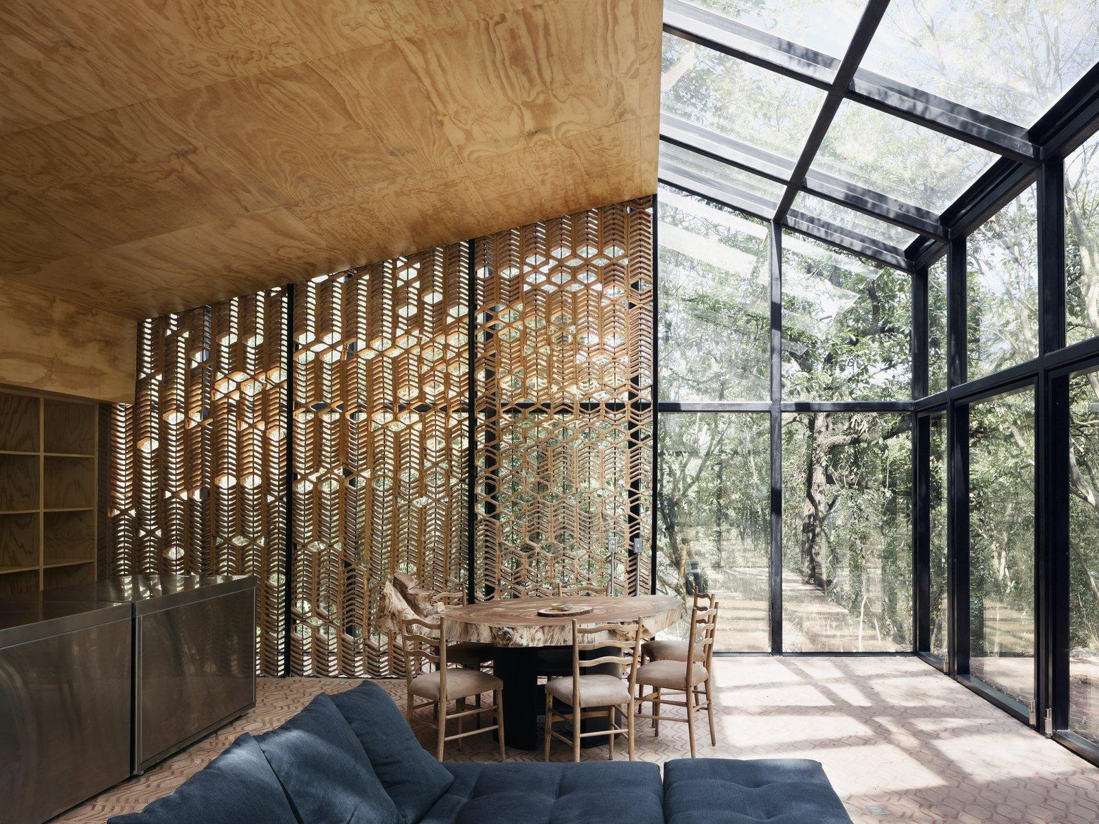 Los Terrenos dining area with wood facade wall