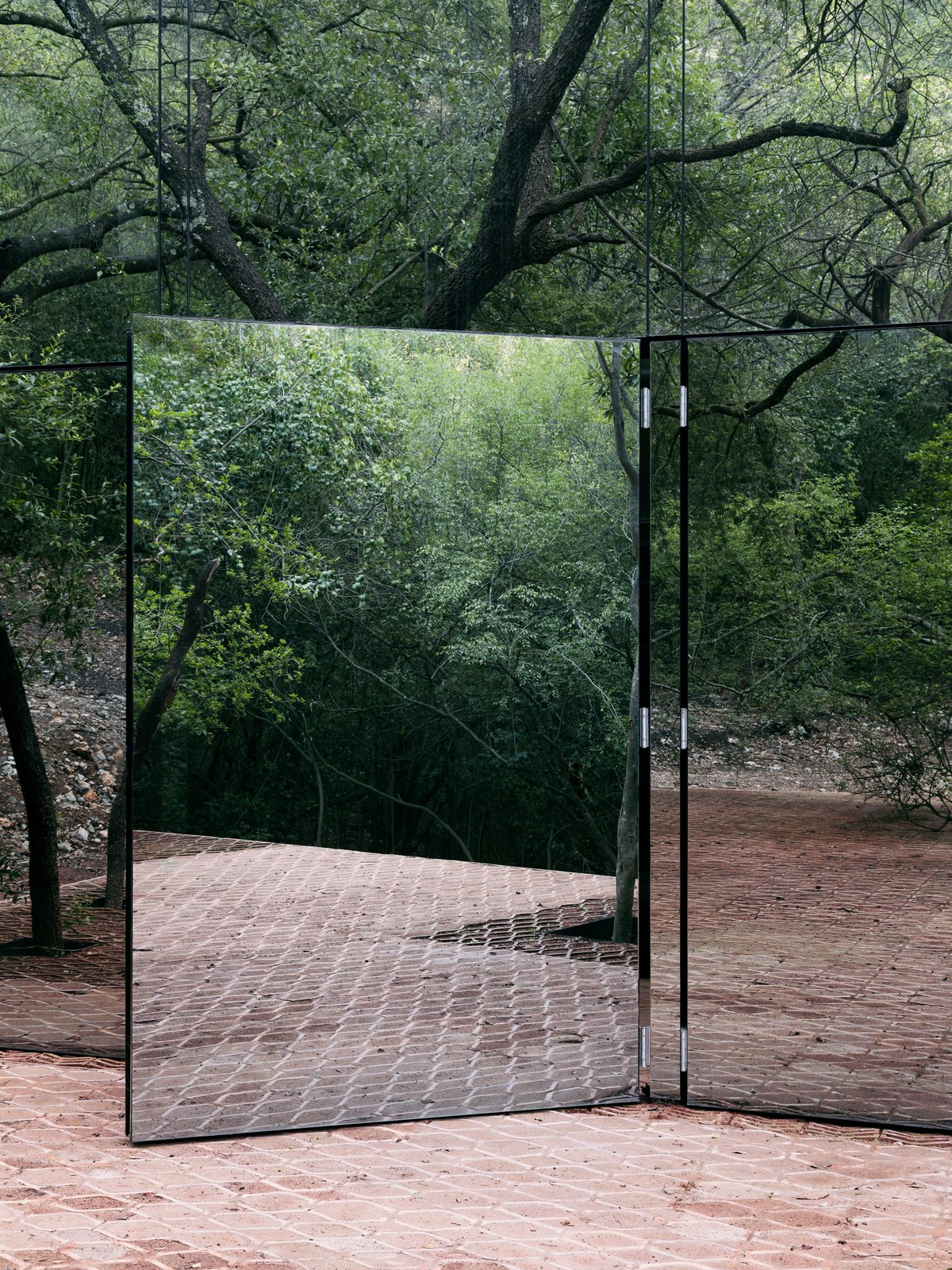 Doors, Exterior, and Swing Door Type The door to the social zones swing open to connect to the terrace.  Photo 8 of 16 in A Mirrored Mexican Home Hides Among a Lush Forest